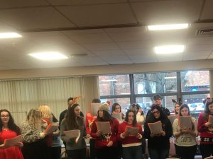 Sixth form students singing in Medway Hospital
